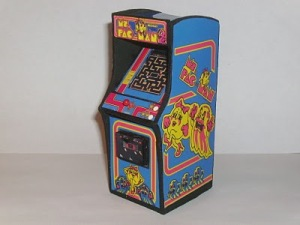 A miniature replica of the Ms. Pac-Man arcade cabinet (source)